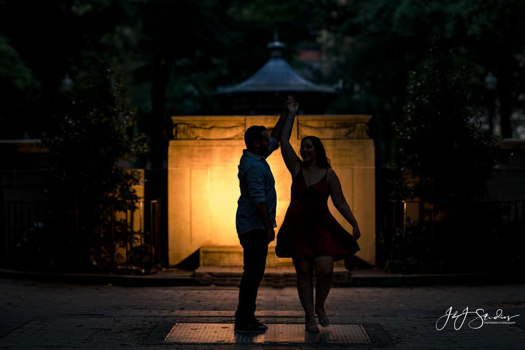 Dancing under the fire light Rittenhouse Square and Addison Street Engagement Shot By John Ryan