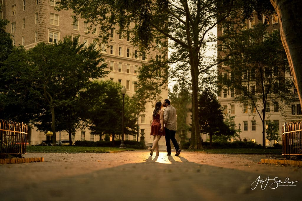 Beautiful couple under sunlight in Rittenhouse Square during Rittenhouse Square and Addison Street Engagement Shot By John Ryan