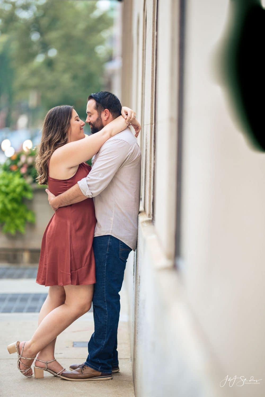 Couple hugging Rittenhouse Square and Addison Street Engagement Shot By John Ryan