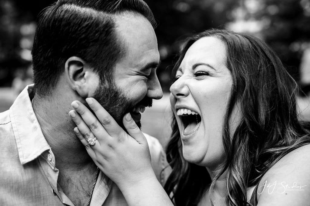 Black and white photo of engaged couple Rittenhouse Square and Addison Street Engagement Shot By John Ryan