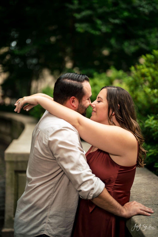 Sara kissing her fiance at Rittenhouse Square Park Shot By John Ryan