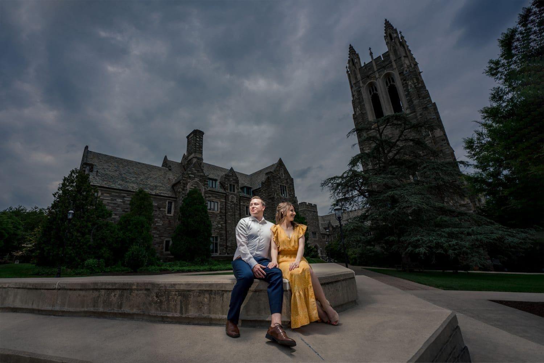 Couple holding hands at night on PA campus Saint Joseph's University Engagement Shot By John Ryan