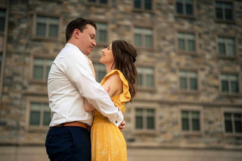Happy in love couple on Philly Campus Saint Joseph's University Engagement Shot By John Ryan