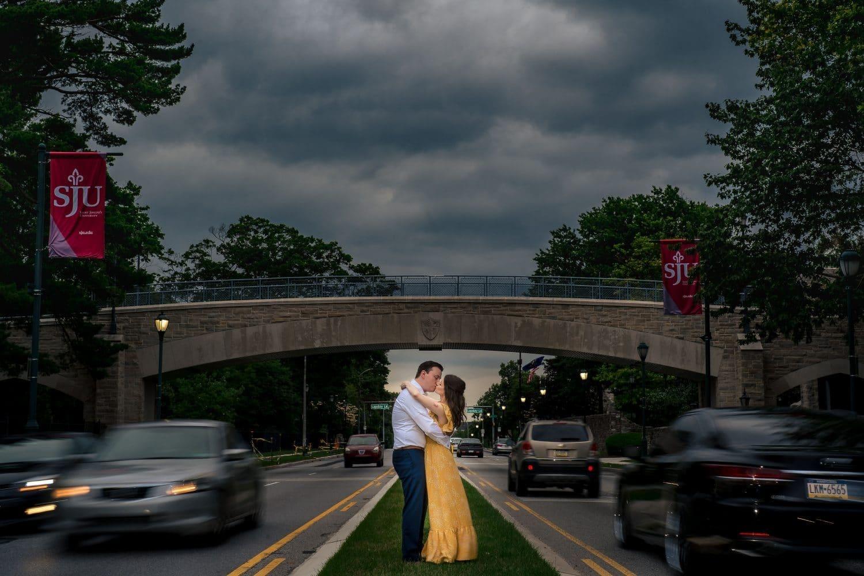 Outside University couple embracing Saint Joseph's University Engagement Shot By John Ryan