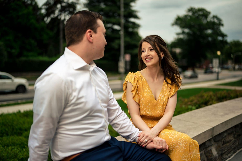 Smiling in love couple on SJU Campus Saint Joseph's University Engagement Shot By John Ryan