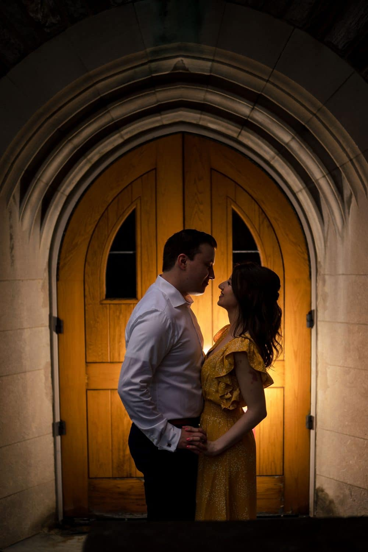 Melissa and George nighttme on SJU campus Saint Joseph's University Engagement Shot By John Ryan