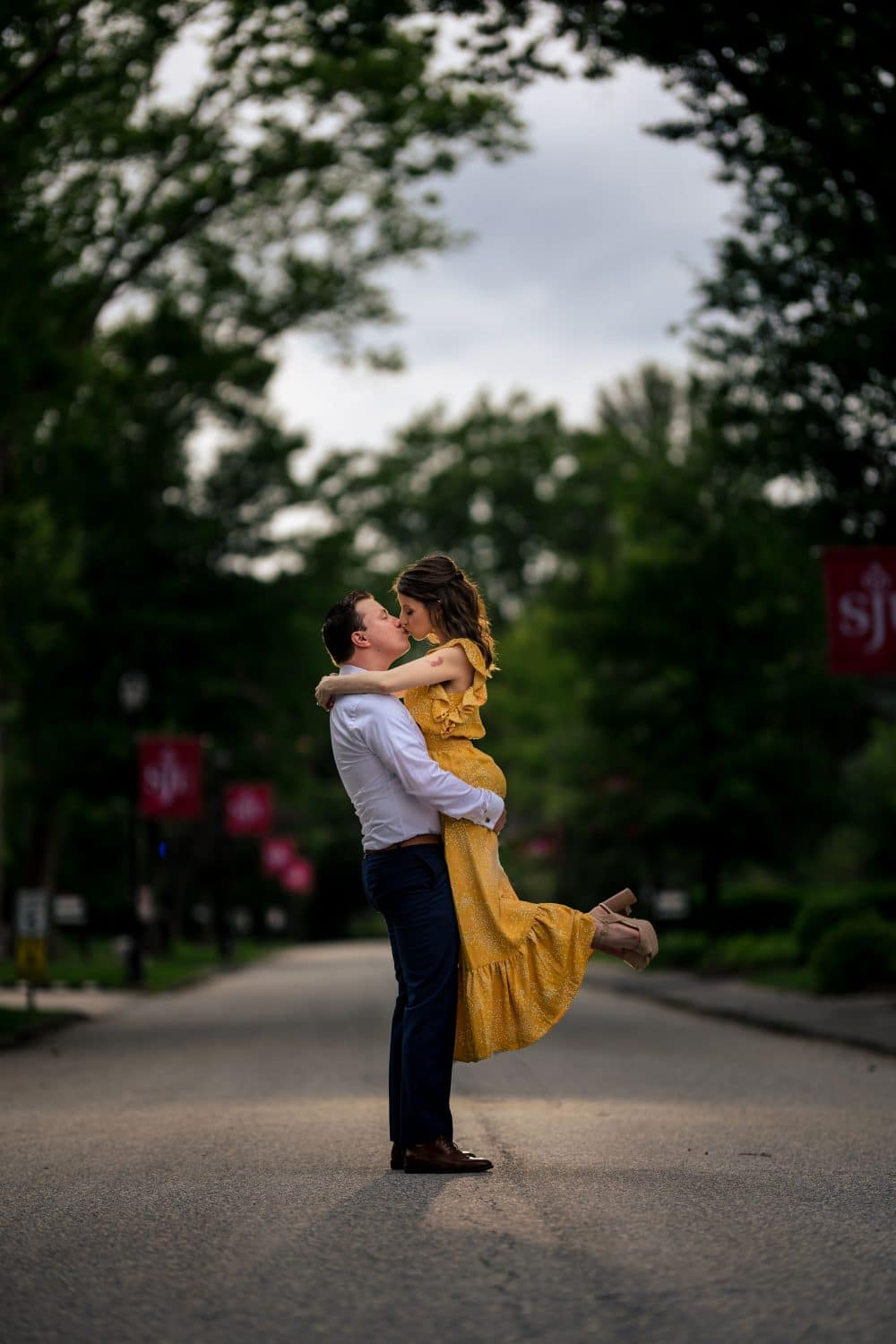 Woman jumped in man's arms with joy in PA Engagement Shoot Shot By John Ryan