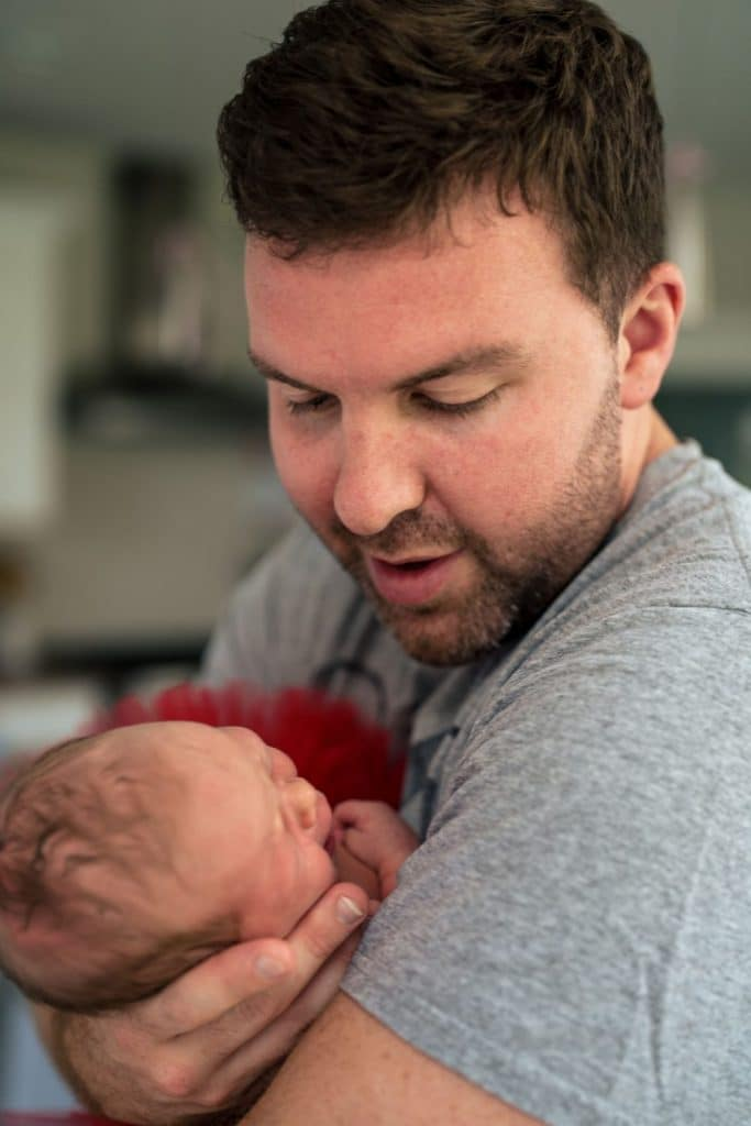 dad holding baby girl photography