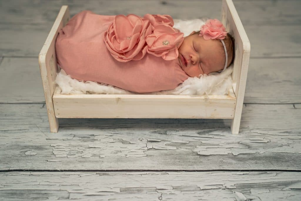 baby girl pink swaddled