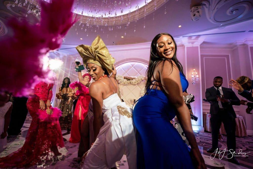 bride dancing with guest wedding reception
