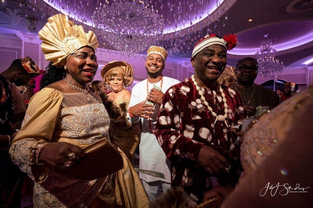 groom dancing with guests wedding reception