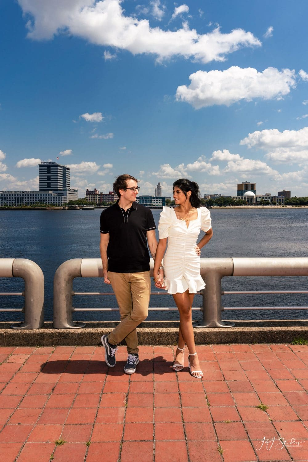 Couple in front of the water by J&J Studios