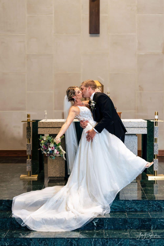 happy bride and groom wedding kiss