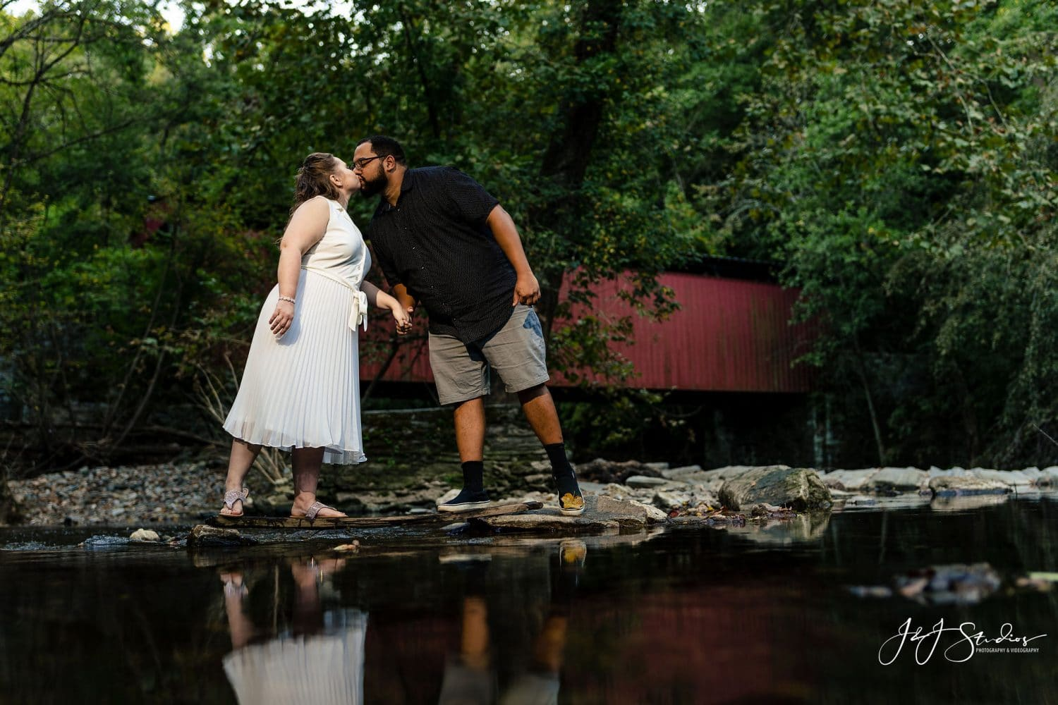 Couple kissing by the water along Philly Trails Shot By John Ryan