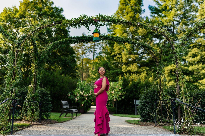 Beautiful woman carrying in pink dress Shot By John Ryan
