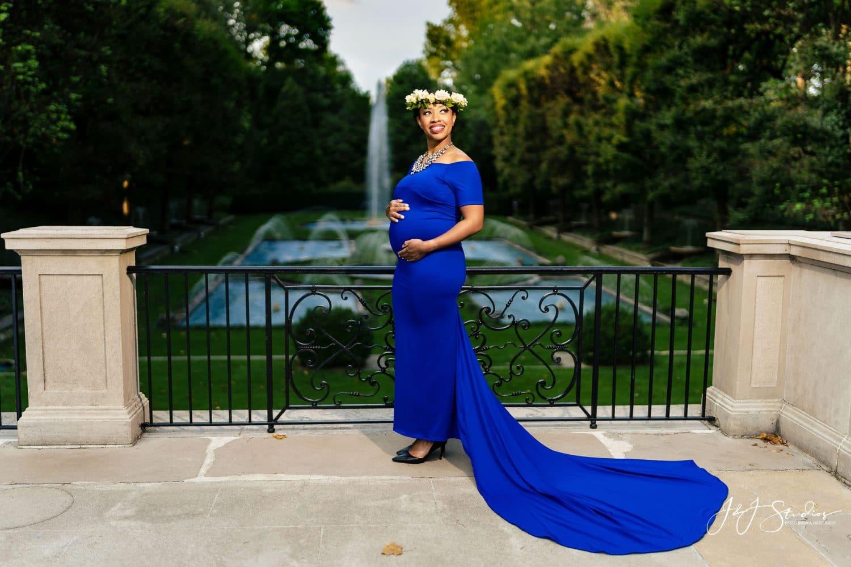 Mother to be in blue flowly dress in Longwood Gardens Shot By John Ryan