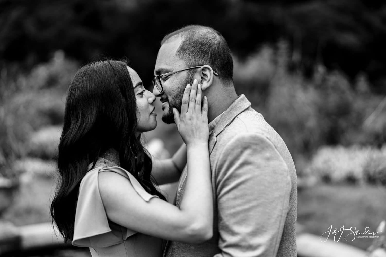 Black and white romantic shot of couple kissing Morris Arboretum Surprise Proposal Shot By John Ryan