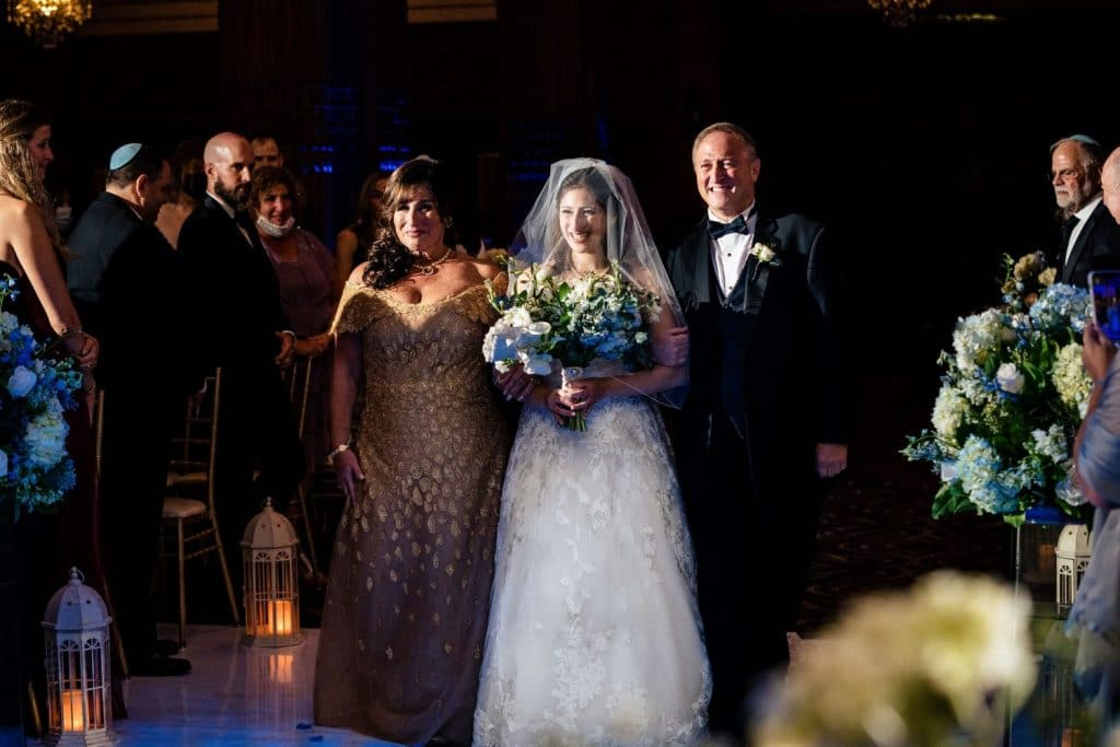 bride walked down the aisle by mother and father
