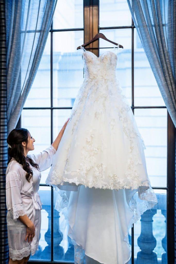 bride looking at wedding dress in window philadelphia pa hotel