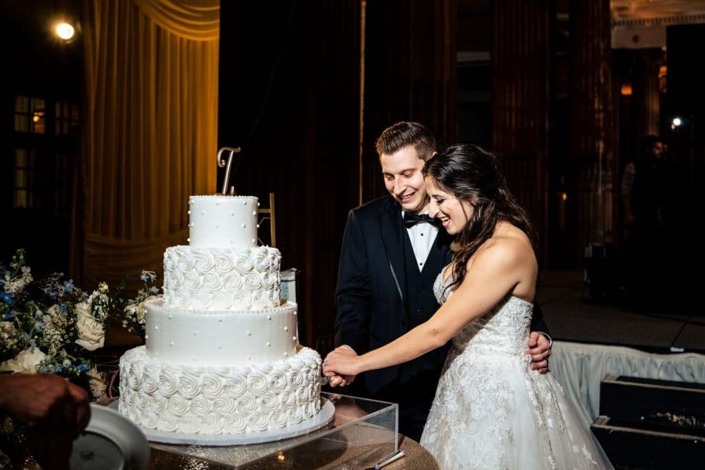 bride and groom cutting wedding cake crystal tea room wedding philadelphia pa