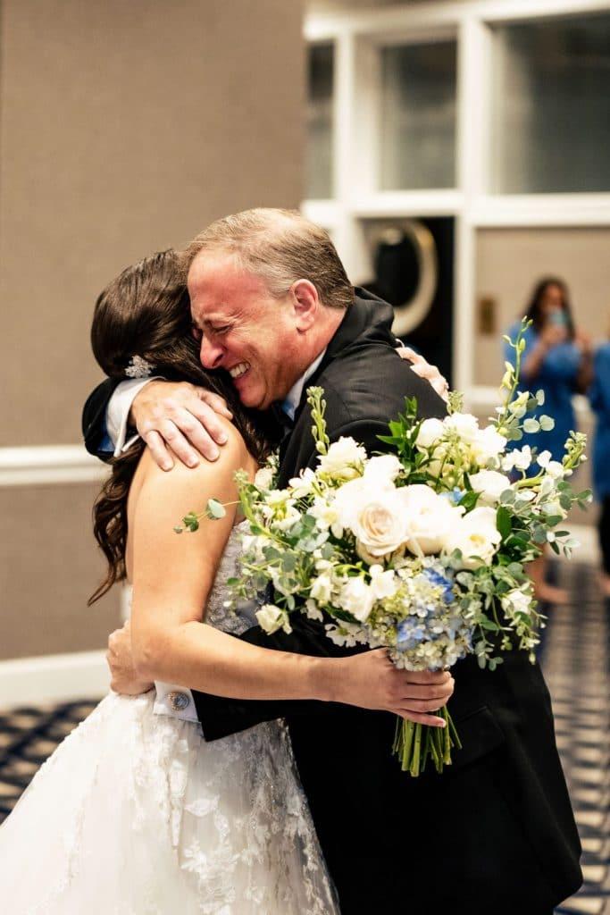 dad hugging daughter on her wedding day philadelphia pa jjstudios
