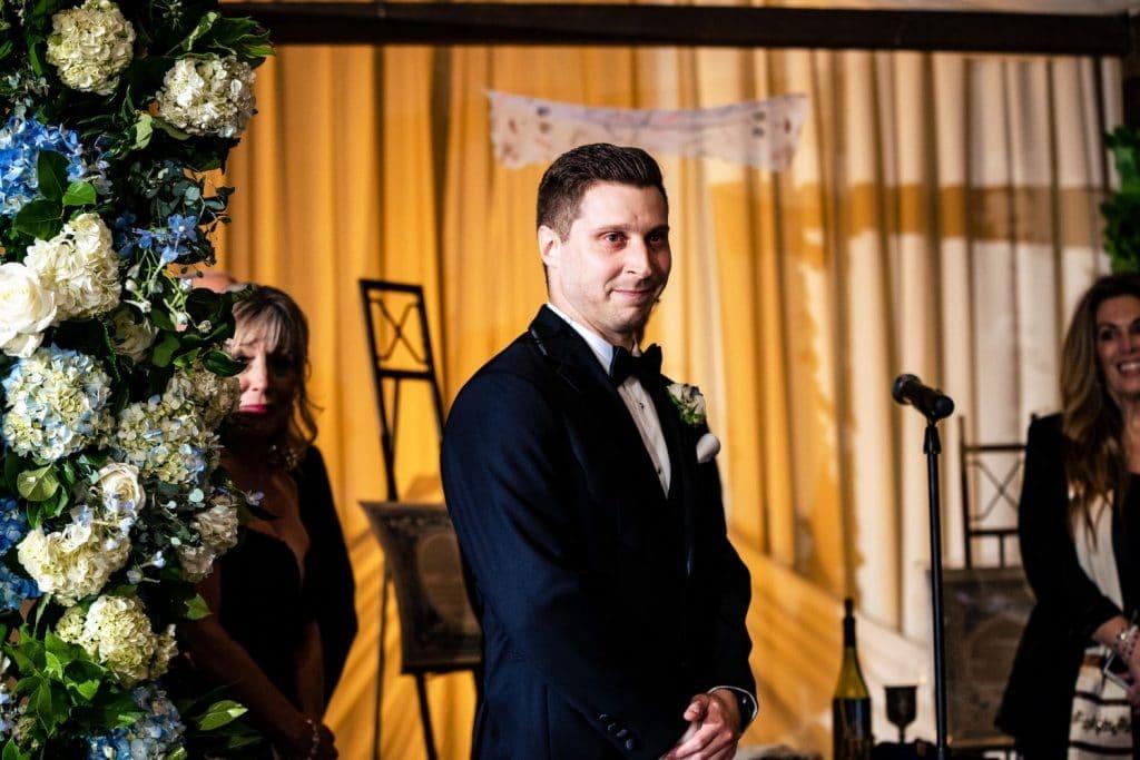 groom seeing bride coming down the aisle crystal tea room wedding