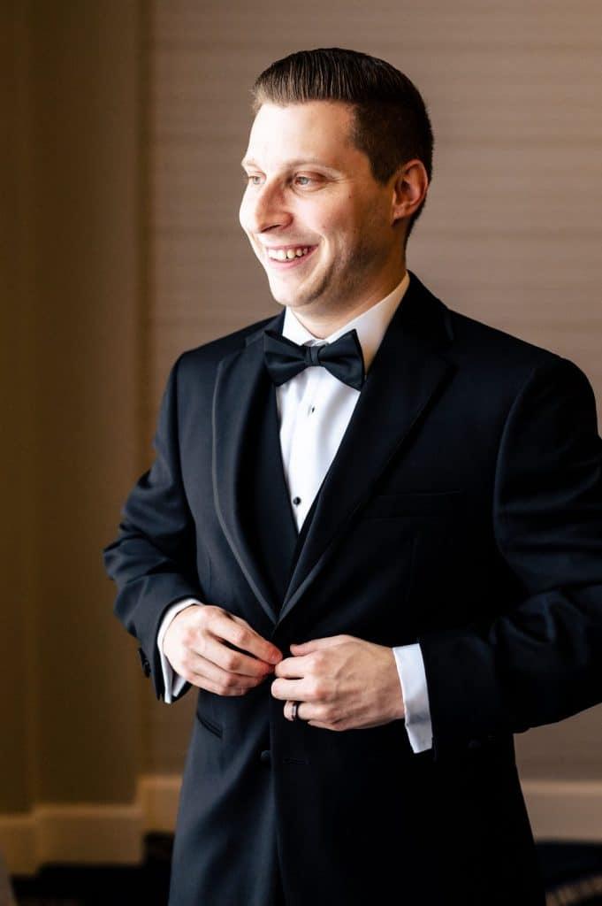 groom smiling portrait wedding day photography