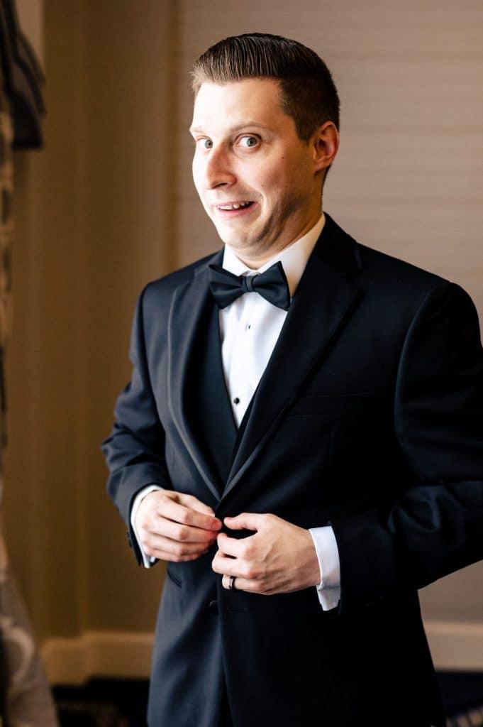 groom making goofy face wedding day