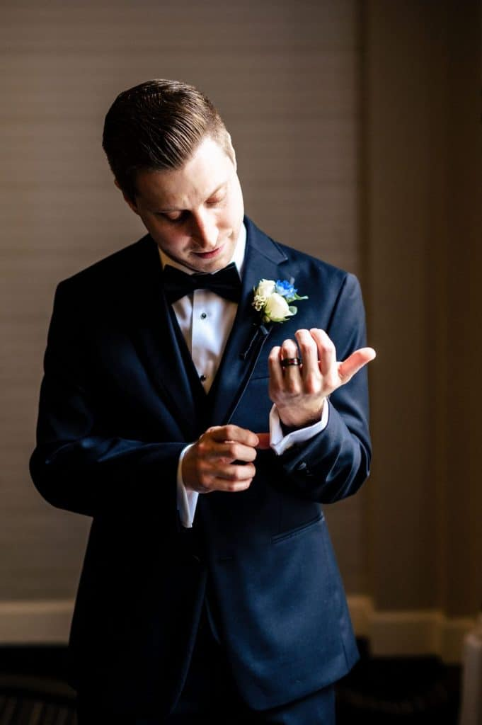 groom portrait wedding day tuxedo