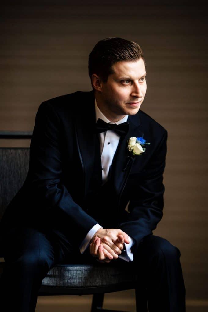 dramatic groom portrait wedding day tuxedo
