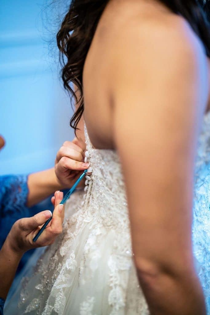 crochet hook to button wedding dress hack