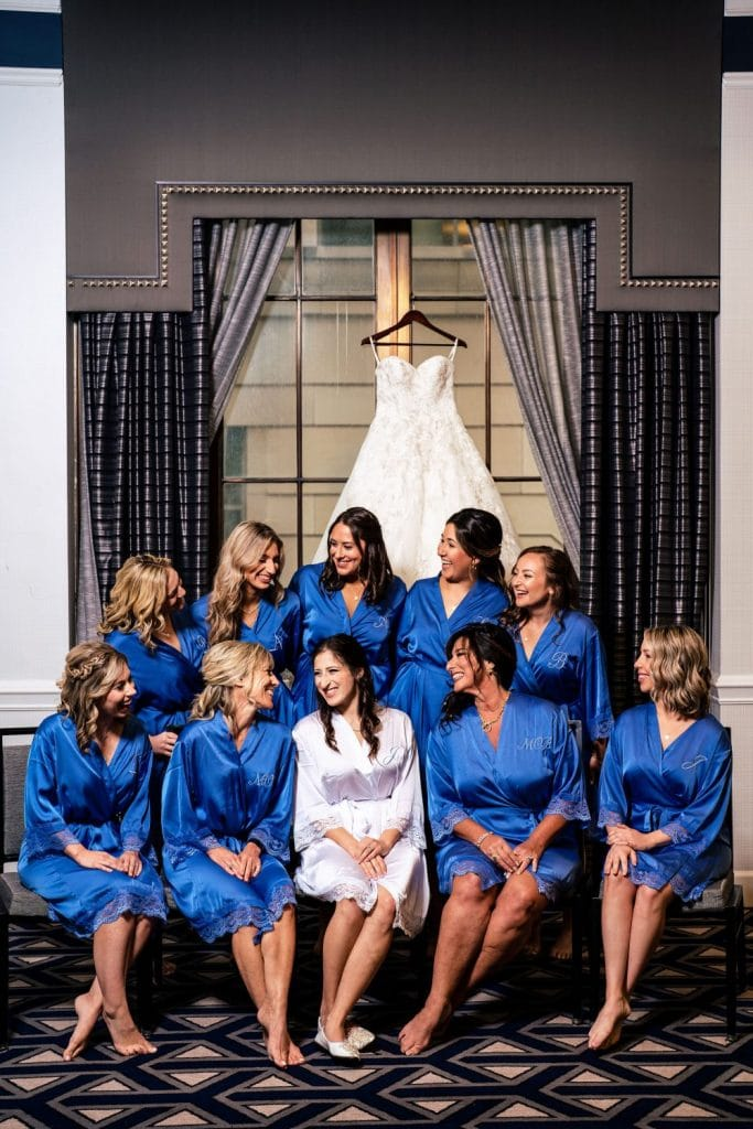 bride and bridesmaids in silk robes getting ready for wedding
