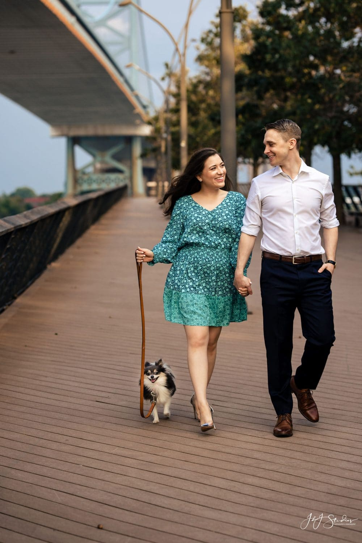Couple walking dog during shoot Jefferson University Medical School Engagement Shot By John Ryan