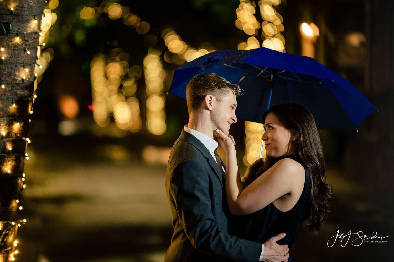Engaged couple under the lights on Addison Street Shot By John Ryan