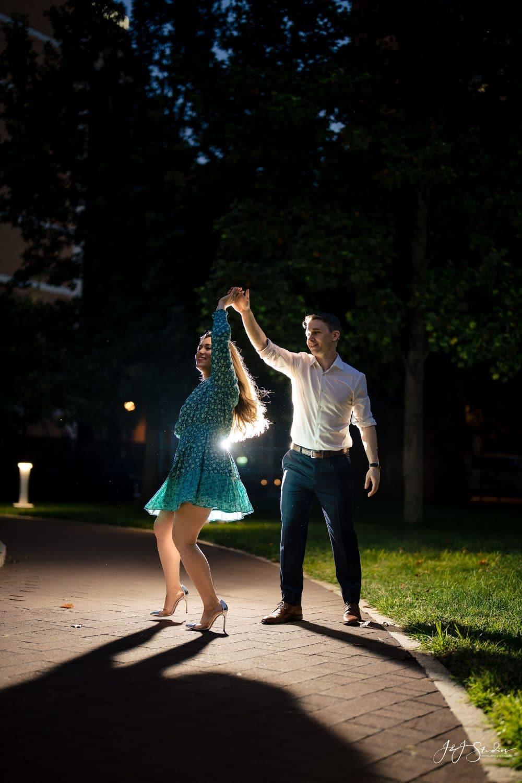 Claudia and Chris dancing under the light at Jefferson University Medical School Shot By John Ryan