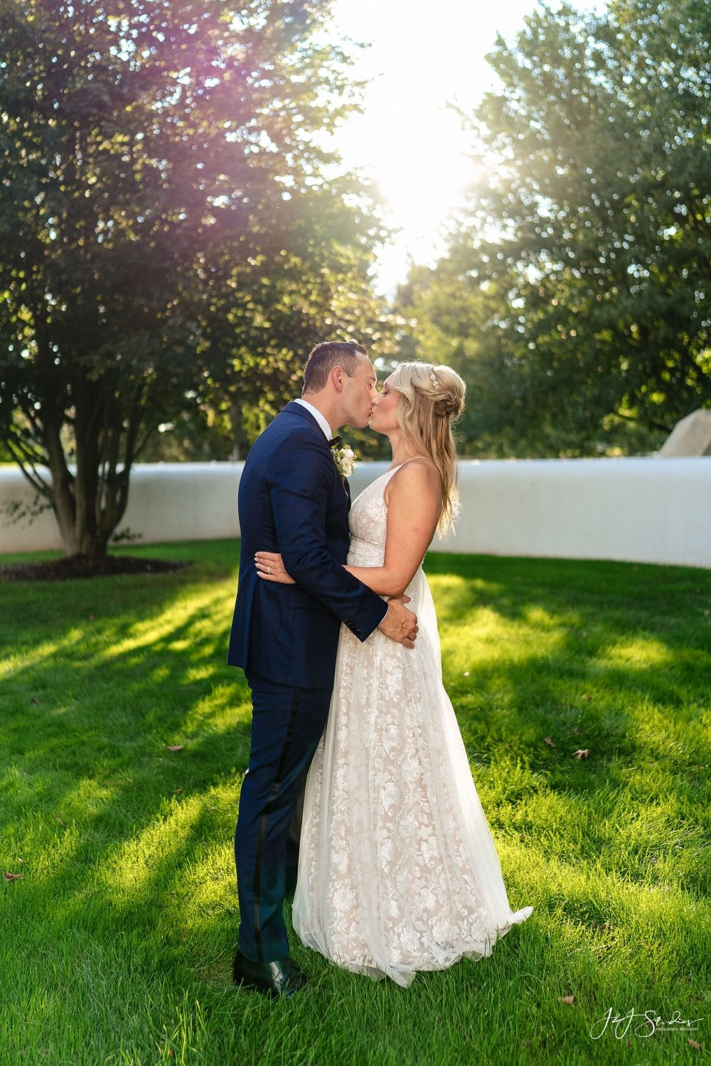 Bride and Groom under the sunlight kissing Shot By John Ryan