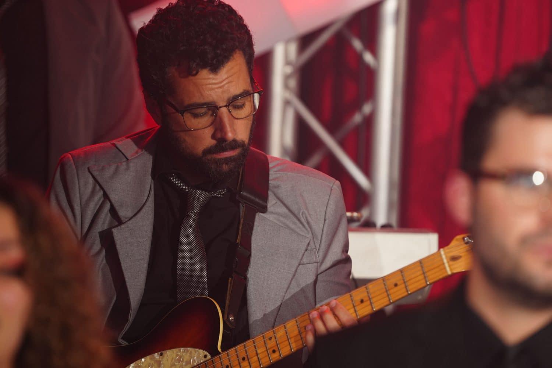 EBE Talent Guitar Player in Band Shot By John Ryan