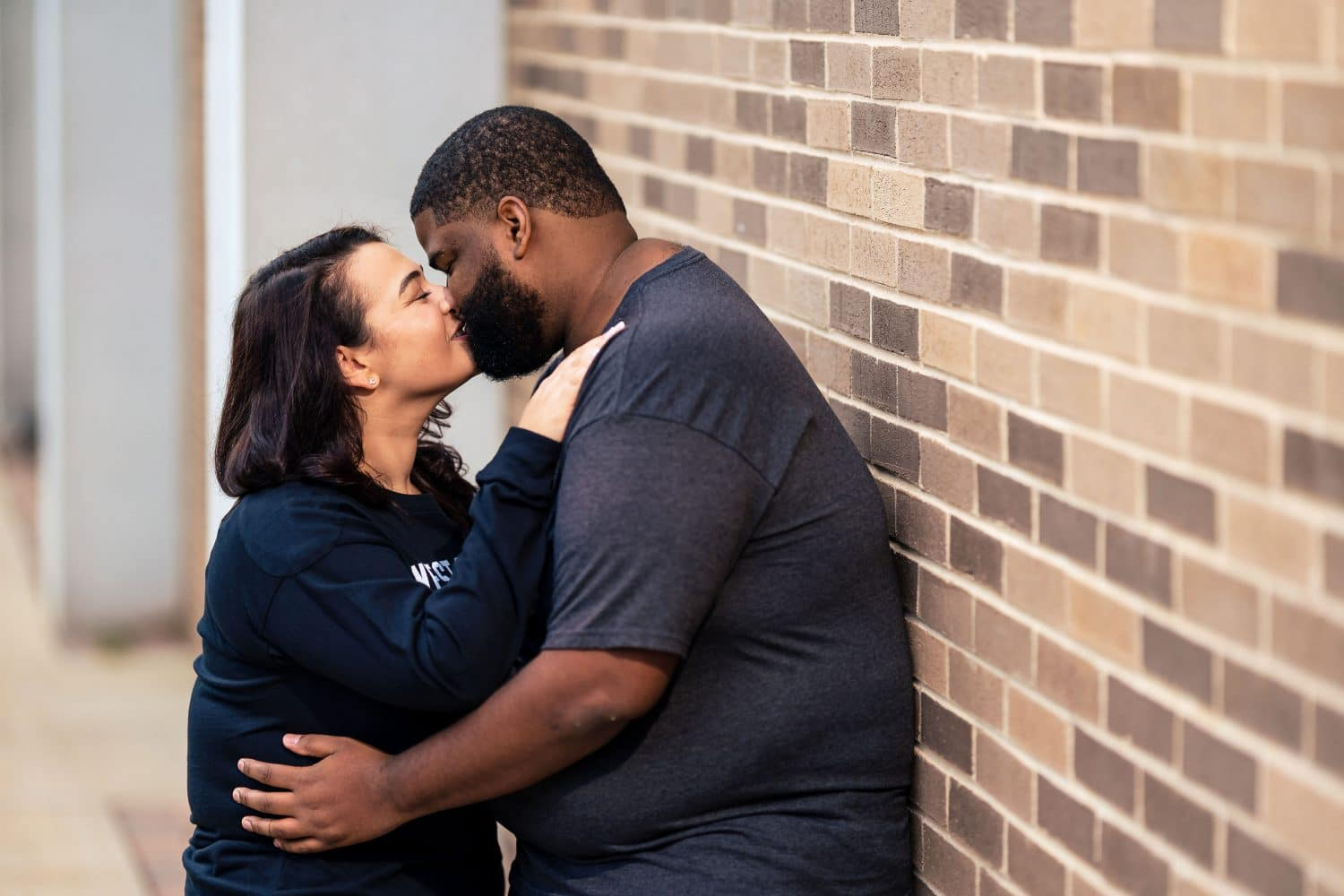 Couple kissing during West Chester University Engagement Session Shot By John Ryan